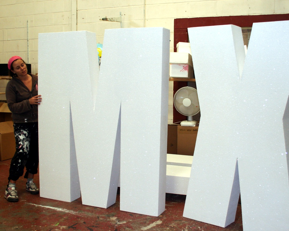 1800mm high polystyrene letters covered in white glitter