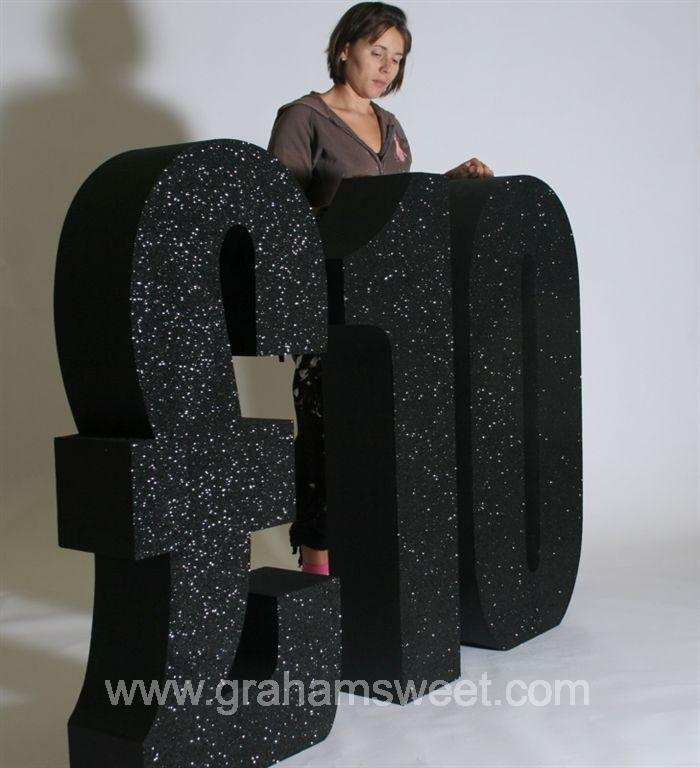 10 - 4 foot high - covered in black glitter